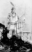 view William Faw Faw or Wawasi in Native Dress with Peace Medal, Headdress, Bear Claw Necklace and Ornaments and Holding Pipe and Bag n.d digital asset number 1