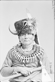 view Standing Bear with Bear Claw Necklace, Ornaments, Headdress and Holding Pipe-tomahawk n.d digital asset number 1
