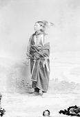 view Grey Eyes in Partial Native Dress with Headdress and Ornaments and Holding Pipe n.d digital asset number 1