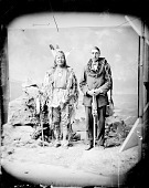 view Arikara man, Rushing Bear and Non-Native Scout, One in Native Dress with Peace Medal and Holding Fan, One with Bear Claw Necklace and Holding Pipe? and Bag 1880 digital asset number 1