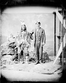 view Lean Wolf and Unidentified White Man, One in Native Dress and Holding Pipe and Bag 1880 digital asset number 1