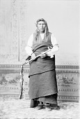 view American Indian Man in Partial Native Dress and Holding Pipe-tomahawk n.d digital asset number 1