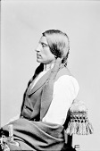 view Portrait (Profile) of Red Shirt in Partial Native Dress with Ornaments and Holding Pipe n.d digital asset number 1