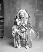 view Tom Hill in Partial Native Dress with Headdress and Holding Pipe-tomahawk ca 1912 digital asset number 1