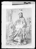 view Photo Portrait of Chief Poor Wolf in Native Dress and with Eye Glasses, Pipe and Pipe Bag 1879 digital asset number 1