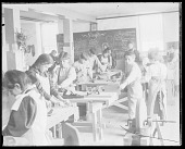 view Carlisle Students Working Inside Carpentry Shop; Non-Native Woman, Teacher, Supervising 1903 digital asset number 1