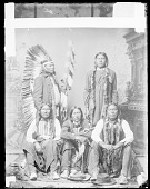 view Five American Indian Chiefs in Partial Native Dress, With Fur-Wrapped Braids, Hairpipe Ornaments, Pipes; One with Feather Headdress and Feathered Wand ? n.d digital asset number 1