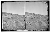 view William R. Pywell photographs from the Yellowstone Expedition digital asset: Men, horses, and wagons descending hill