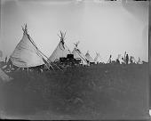view Row of tipis on powwow camp ground digital asset: Row of tipis in powwow camp ground