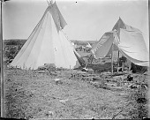view Tipi and tent on powwow camp ground digital asset: Tipi and tent on powwow camp ground