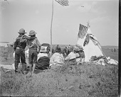 view Group of men and boys sitting beside tipi on powwow camp ground digital asset: Group of men and boys sitting beside tipi on powwow camp ground