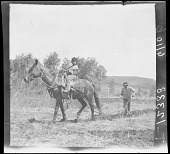 view Horse pulling plow guided by Apache man. Young boy astride horse. 1903 digital asset number 1