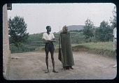 view Mubamba and grandson (with a piece of Datus showing), circa 1957 digital asset number 1