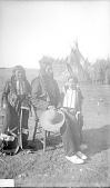 view Arapaho man and two young girls digital asset: Arapaho man and two young girls