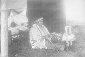 view Woman in Native Dress with Breastplate and Holding Cradleboard and Pipe n.d digital asset number 1