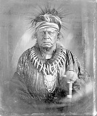 view Portrait (Front) of Kiyo-Kaga (One Who Moves About Alert), Called Keokuk, in Partial Native Dress with Peace Medal, Bear Claw Necklace, Headdress and Ornaments 1868 digital asset number 1