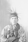 view Portrait (Front) of Sam Brown? in Partial Native Dress with Headdress and Ornaments 1898 digital asset number 1