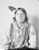 view Portrait (Front) of Kishkinniequote, Called Jim Deer, in Partial Native Dress with Ornaments JAN 1907 digital asset number 1