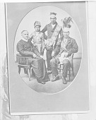 view Group Portrait of Father Vermilljou in Clerical Garb and with Two Men and One Boy, All in Partial Native Dress with Headdresses, One with Ornaments 1907 digital asset number 1