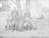 view Group of SIx near Tree and Wood Frame Building 1900 digital asset number 1