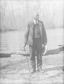 view Man near Row Boats in River 1900 digital asset number 1