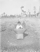 view Two Year-Old Boy Sitting in Basket 1909 digital asset number 1