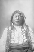 view Portrait (Front) of Sentele, Also Called Grant Richards, in Partial Native Dress with Breastplate, Feather Hair Charm and Ornaments 1898 digital asset number 1