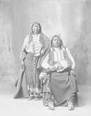 view Portrait of Sentele, Also Called Grant Richards, with His Wife, Winnie Richards, Both in Partial Native Dress with Ornaments, One with Breastplate and Hair Charm and Holding Fan 1898 digital asset number 1