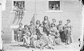 view Group of Twenty-One Children Near Boarding School, One Holding Pipe-tomahawk, One Holding Bow and Arrows n.d digital asset number 1