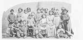 view Group of Twenty-Four Children Near Boarding School, One Holding Quirt, One Holding Arrow n.d digital asset number 1