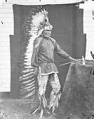 view Peta-La-Sha-Ra (Manchief The Younger) in Partial Native Dress with Headdress and Ornaments and Holding Pipe-tomahawk 1871 digital asset number 1