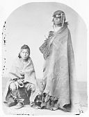 view Portrait (Front) of Caw-Heek (An Old Man) and with Boy, Both in Buffalo Robes and Partial Native Dress 1868 digital asset number 1