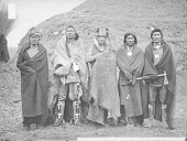 view Group of Five Near Earth Lodge, All in Native Dress with Ornaments, Two with Peace Medals, Two Holding Pipe-tomahawks, One with Bear Claw Necklace and Headdress 1868 digital asset number 1