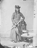 view Portrait (Front) of Long Knife in Partial Military Uniform and Native Dress and Holding Sword 1877 digital asset number 1