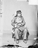 view Portrait (Front) of Black Buffalo in Partial Military Uniform and Native Dress with Peace Medal and Holding Pipe-tomahawk 1877 digital asset number 1