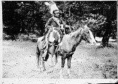 view Mobile, Government Scout, in Native Dress with Headdress and Holding Shield On Horseback n.d digital asset number 1
