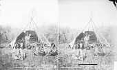 view Group of Nine in Partial Native Dress Near Tipi Frame, One Holding Rifle 1873 digital asset number 1