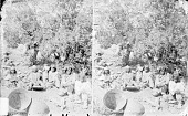 view Family Group of Eight, All in Native Dress, One in Cradleboard, One with Mano and Metate; Clay Pots and Baskets Nearby 1873 digital asset number 1