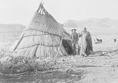 view Chief Ocheo and Man, Both in Partial Dress, Near Brush Tipi 1906 digital asset number 1