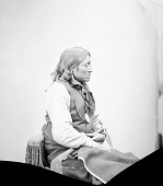 view Portrait (Profile) of Quirts-Quip (Chewing Elk) in Partial Native Dress with Peace Medal and Ornaments and Holding Pipe- Tomahawk 1872 digital asset number 1
