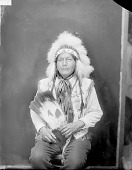 view Portrait (Front) of Albert Attocni or At-Tock-Nie (Lone Tipi) In Beaded Jacket and Headdress and Holding Fan MAY 1924 digital asset number 1