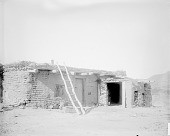 view One-story Adobe House, Baskets Near Door n.d digital asset number 1
