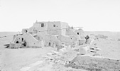 view View of Adobe House Cluster, House of the Captain of the Tewas, Seven People Nearby 1875 digital asset number 1