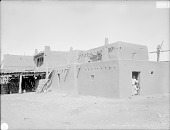 view Adobe House Cluster in New Town Viewed From Southeast; Two Women in Doorway of House 1899 digital asset number 1