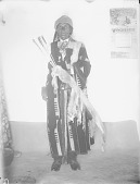view Governor Francisco Vigil in Native Dress with Ornaments and Holding Quiver and Arrows; Near Adobe Wall 1899 digital asset number 1