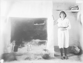 view [An unidentified Acoma woman with house interior showing fireplace] 1899 digital asset number 1