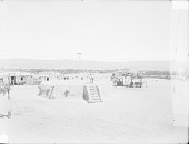 view View of Plaza in Pueblo Showing Circular Kiva; Adobe House Cluster, Wagons, and Storage Shed Nearby 1899 digital asset number 1