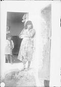 view Three Children in Two Doorways of Adobe House Cluster 1899 digital asset number 1