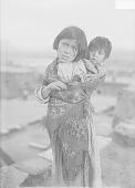 view Young Girl with Child On Back 1911 digital asset number 1