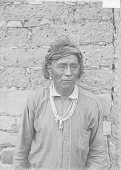 view Man in Partial Native Dress with Ornaments Near Adobe Wall 1911 digital asset number 1